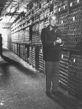 Baron Philippe De Rothschild in a Wine Cellar at Chateau Mouton Rothschild Photographic Print by Carlo Bavagnoli