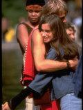 Youthful Hippie Couple Embracing Premium Photographic Print by Vernon Merritt III