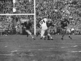 Navy Quaterback, George Welsh, Running, Grim-Faced, During Army-Navy Game Photographic Print by John Dominis