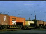 Line of Railroad Box Cars Lit by Late Day Sun Photographic Print