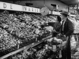 Couple Shopping for Food Premium Photographic Print by Ed Clark