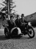 Three Chimney Sweeps Riding a Motorcycle Premium Photographic Print by Dmitri Kessel