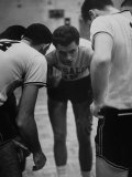 Basketball Player Tom Gola in a Huddle During a Basketball Game Premium Photographic Print