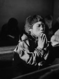 Young Eskimo Boy Attending Church, Praying During Church Services Premium Photographic Print