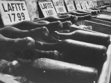 Bottles of Lafite Wines, Now Museum Pieces in French Wine Cellar Reproduction photographique par Carlo Bavagnoli