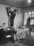 Freshman Mary Lloyd-Rees Hanging Both Harvard and Yale Banners in Her Room Photographic Print by Lisa Larsen