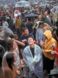 Faces in Crowd During Rainy Spell at Woodstock Music and Art Festival Premium Photographic Print