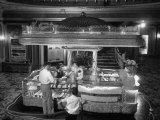 Man Buying Snacks at the Movie Concession Stand Premium Photographic Print by Peter Stackpole