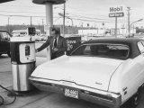 Motorist Filling Up His Own Car at a Self Service Gas Station Premium Photographic Print by Ralph Morse