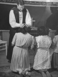 Bishop Arthur B. Kinsolving, Laying His Hands on a Young Girls Head During Prayer Premium Photographic Print by Martha Holmes