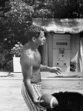 Attorney General Robert F. Kennedy Holding Football, with Dog Nearby, at His Swimming Pool Premium Photographic Print