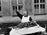 Vendor Trying to Sell Bundles of Sausage Premium Photographic Print by Margaret Bourke-White