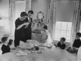 Robert F. Kennedy and His Wife Preparing Son Michael, for Baptism Photographic Print by Ed Clark