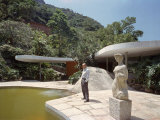 Architect Oscar Niemeyer Standing Beside Pool at His Private Residence Premium Photographic Print by Dmitri Kessel