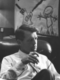 Robert F. Kennedy Sitting in Office in Front of Child's Painting Premium Photographic Print