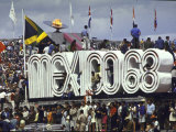 People Climbing and Sitting on a Mexico '68 Sign at the Summer Olympics Premium Photographic Print by John Dominis