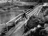 Young Boy on His Bike at Bridge Watching River Premium Photographic Print
