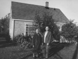 An Older Levittown Couple, Standing in Front of their New Home Premium Photographic Print