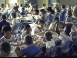 At the Integrated Richards School, Students Having Lunch in Cafeteria Premium Photographic Print