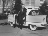 President of American Motors George W. Romney Getting Out of His Car Premium Photographic Print by Grey Villet
