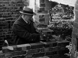 Winston Churchill Building a Brick Doll House for His Youngest Daughter Photographic Print