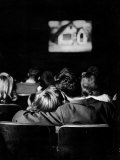 Teenagers &quot;Necking&quot; in a Movie Theater Premium Photographic Print by Nina Leen