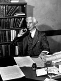 Bertrand Russell Sitting at His Desk at California University at Los Angeles Photographic Print by Peter Stackpole