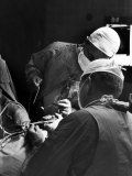 Brain Surgeon Irving S. Cooper Performing Operation Which Often Helps Relieve Parkinson's Disease Premium Photographic Print by Alfred Eisenstaedt