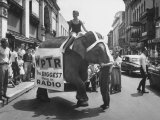 Girl Riding Elephant as a Publicity Stunt for a Radio Station Premium Photographic Print by Peter Stackpole