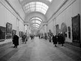 Patrons Looking at Art in a Gallery of the Louvre Premium Photographic Print by Dmitri Kessel