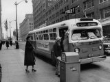 Scene from Seattle During Free Ride Day, with People Boarding a Bus Photographic Print