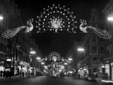 Christmas Decorations Hung across Regent Street in London Premium Photographic Print