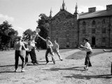 Group of Kenyon College Students Playing W. a Frisbee Like Flying Disc Premium Photographic Print