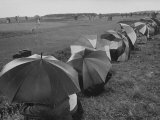 Heavy Downpour Has Spectators Cringing under Umbrellas at British Open Premium Photographic Print by Carl Mydans