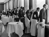 Waiters in the Grand Hotel Dining Room Lined Up at Window Watching Sonia Henie Ice Skating Outside Fotoprint van Alfred Eisenstaedt