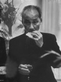 Indo Chinese Communist Leader Ho Chi Minh Eating at a Reception During His Official Visit to Poland Premium Photographic Print by Lisa Larsen