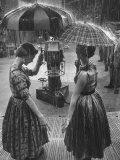 "Models Demonstrating Umbrellas under Artificial Rain on TV Program ""Home"" Premium Photographic Print by Ralph Morse"
