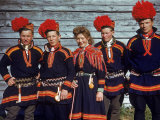 People in Traditional Costumes in Lapland Premium Photographic Print