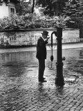 Man Drinking from Public Water Pump Fountain on Street, Frankfort-On-The-Main, Germany Premium Photographic Print by Alfred Eisenstaedt