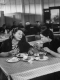 Woman and Her Daughter Eating in a Restaurant Premium Photographic Print by Lisa Larsen