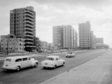 Cars Driving Past New Hotels under Construction Re Growing Gambling Industry in Havana Premium Photographic Print