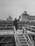 Emperor Hirohito Standing on Platform and Waving to the Crowd Premium Photographic Print by Carl Mydans