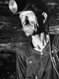 Coal Miner with Head Gear on Working in Mine Photographic Print by Dmitri Kessel