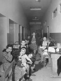 Refugees Living in Corridor of School Building Premium Photographic Print by Dmitri Kessel
