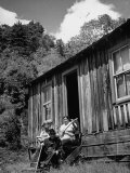 Mountain Farm Family Sitting in Front of their House Premium Photographic Print by Ed Clark