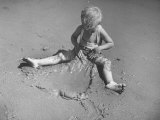 Little Boy Playing on the Beach at Ebb Tide Premium Photographic Print by Bernard Hoffman