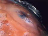 Volcanic Eruptions of Pele on Moon Io Taken by Spacecraft Voyager 2 Premium Photographic Print