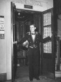 "Young Man Blocking the Entrance to the ""Lift"", in America it Is Called an Elevator Premium Photographic Print"