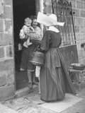Nun from the Order of Sisters of Charity Visiting a Destitute Family with Supplies Premium Photographic Print
