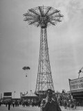People Enjoying a Ride at Coney Island Amusement Park Premium Photographic Print by Ed Clark